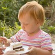 The child eats a pie — Stock Photo