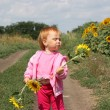 Child and sunflower — Stock Photo #1303560
