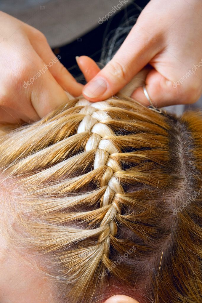Close-up of weaving of a plait — Stock Photo #2553557