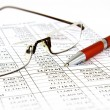 Financial report with pen and glasses — Stock Photo #1126536