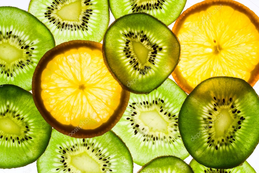 Kiwi fruit and orange in backlight. Background  Stock Photo #1126550
