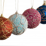 Four handicraft christmas balls — Stock Photo