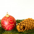 Royalty-Free Stock Photo: Red christmas ball and cone