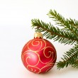 Stock Photo: Red christmas ball and firtree brunch