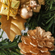 Stock Photo: Golden pine cone on christmas tree