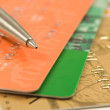 Pen, credit cards, banknotes and coins — Stockfoto