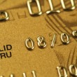 Closeup of fragment of gold credit card — Stock Photo #1143000