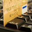 Gold credit card on computer keyboard — Stock Photo #1143004