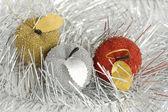 Three christmas tree apples in glare — Stock Photo