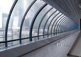 Glass corridor in modern office centre — Stock Photo