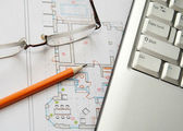 Laptop, glasses and pencil on house plan — Stock Photo