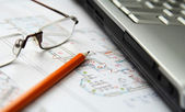 Laptop, pencil and glasses on home draft — Stock Photo