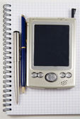 Vignetting image of pen and PDA — Stock Photo