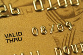 Closeup of fragment of gold credit card — Stock Photo