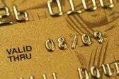 Closeup of fragment of gold credit card — Stock Photo