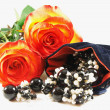 Two beautiful roses and jewelery for dar - Stock Photo