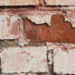 Closeup image of weathered painted brick — Stock Photo