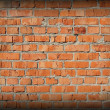 Vignetting image of red brick wall - Stock Photo