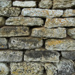 Fragment of flat stone wall texture - Stock Photo