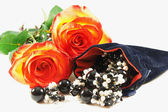 Two beautiful roses and jewelery for dar — Stock Photo
