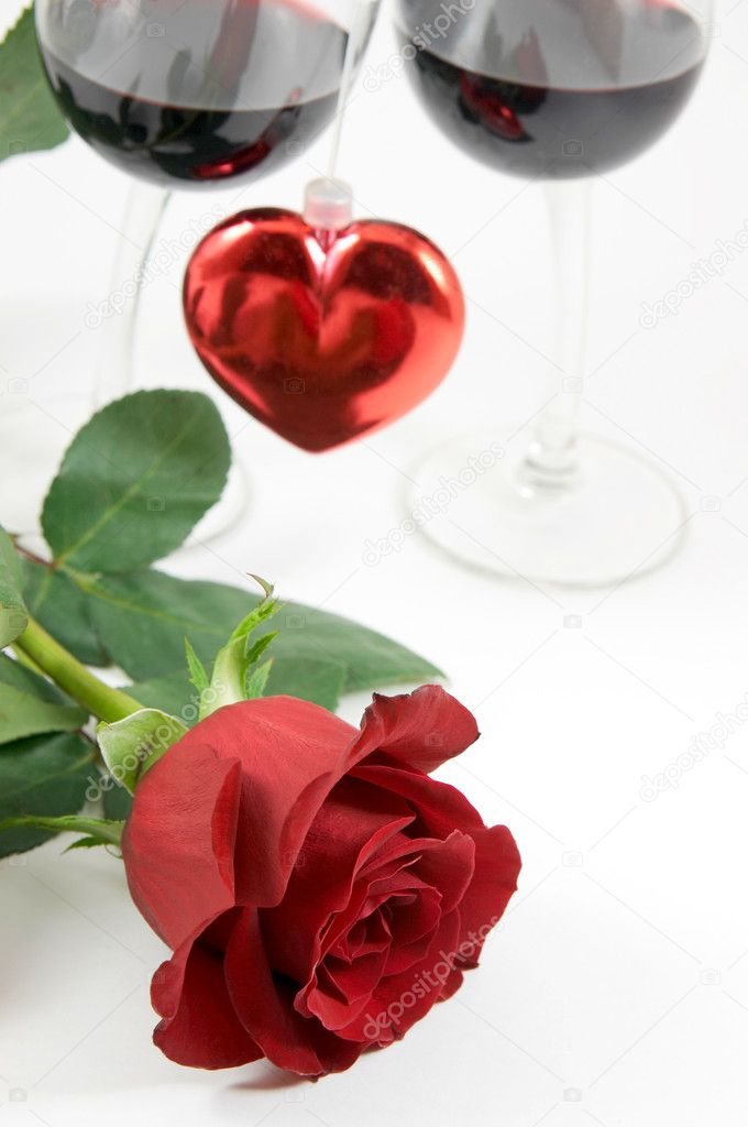 Beautiful red rose, heart and two glasses of wine  Stock Photo #1173700