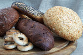 Different bread on kitchen board — Stock Photo