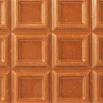 Closeup milk chocolate bar with nuts — Stock Photo #1240381