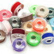 Stock Photo: Spools of color thread