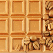 Closeup chocolate bar with coffee beans — Stock Photo