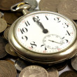 Old pocket watch on the coins — Foto Stock