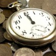 Old pocket watch on the coins — 图库照片