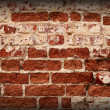 Old weathered red brick wall background — Stock Photo