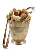 Ice tongs and bucket filled with corks — Stock Photo