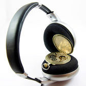 Old watch in headphones isolated — Stock Photo
