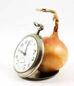 Old watch and onion — Stock Photo
