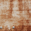 Two rivets on rusty iron surface — Stock Photo