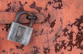 Old padlock on rusty metal door — Stock Photo