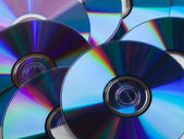 Many DVDs as background — Stock Photo