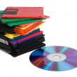 Compact disk and pile of diskettes — Stock Photo #2386570