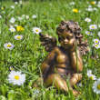 Stock Photo: Angel in grass