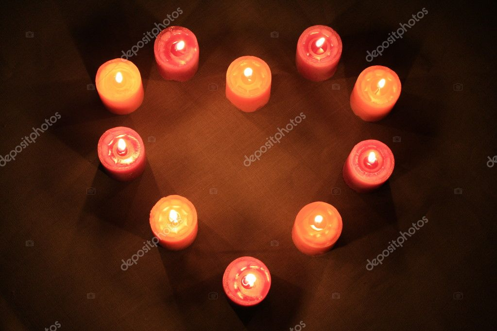 Some candles in heart-shaped composition on linen background — Stockfoto #1108348