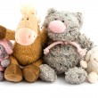 Four plush toys - Stock Photo