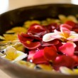 Flower petals in bowl at spa — Stock Photo #1136381