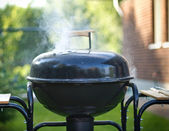 Cooking in a barbeque — Stock Photo
