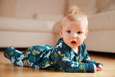 6 month old baby crawling on floor at home — Stok fotoğraf