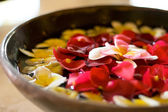 Flower petals in a bowl at a spa — Stock Photo