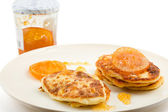 Small cottage pancakes with orange jam — Stock Photo