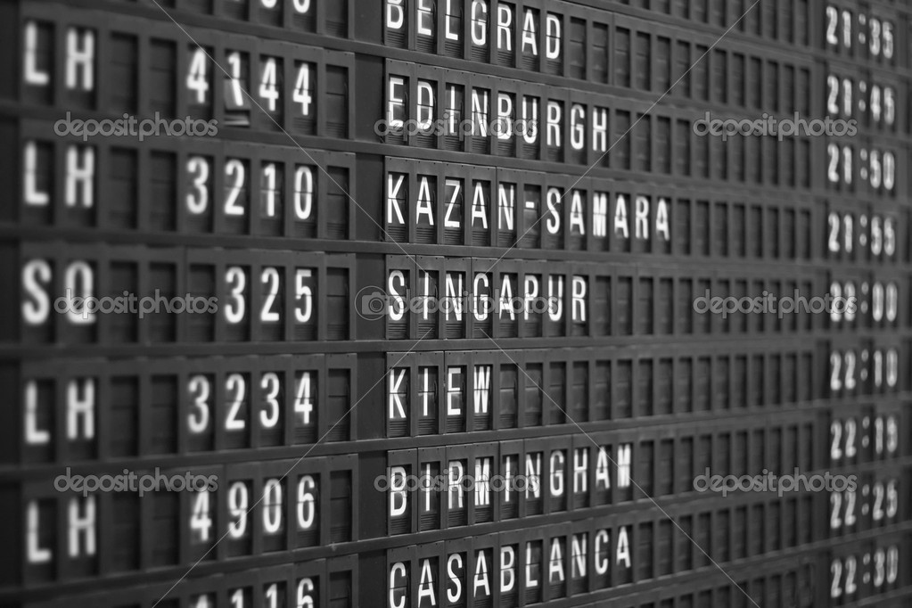 Flight schedule display in airport, shallow DOF — Stock Photo #1136155