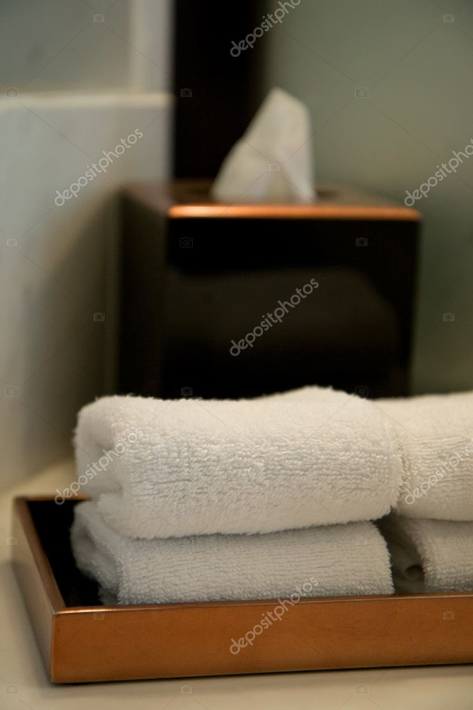 Pile of towels in a hotel bathroom, shallow DOF  Stock Photo #1136206
