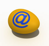 Yellow egg with figure of an ape tail (@ — Stock Photo